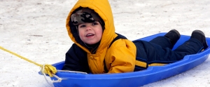 boy on blue sled header