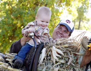 lil guy and dad on cornstalk horse low