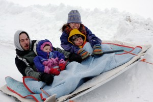 family on sled