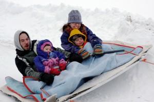 family on sled