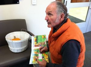 Papa signing book