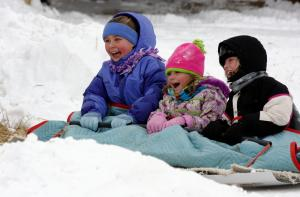 girls on sled