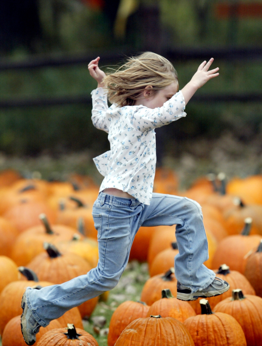 girl jumping pumpkins revised